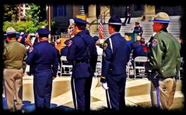 Officers With Roses - Fallen Officer Memorial 2014